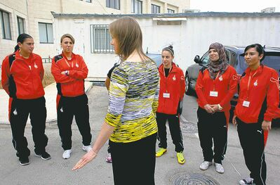 Klassen talks to members of a Palestinian soccer team.