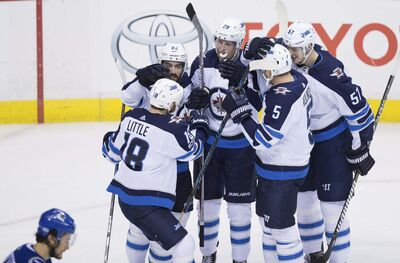 THE CANADIAN PRESS / Darryl Dyck</p><p>Winnipeg Jets&#39; Bryan Little, from left to right, Mathieu Perreault, Patrik Laine, Dmitry Kulikov and Tyler Myers celebrate Laine&#39;s goal against the Vancouver Canucks during the second period of their NHL hockey game in Vancouver, B.C., on Thursday.</p>