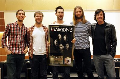 FILE - Members of American rock band Maroon 5, from left, Jesse Carmichael, Mickey Madden, Adam Levine, James Valentine and Matt Flynn, pose during a press conference at the Singapore Indoor Stadium in this April 25, 2011 file photo taken in Singapore. The Grammy-winning band announced Monday April 1, 2013 that they will headline the 2013 Honda Civic Tour, which kicks off Aug. 1 in St. Louis and will feature Kelly Clarkson. (AP Photo/Wong Maye-E, File)