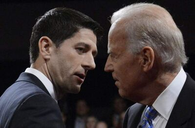 Vice-President Joe Biden and Republican vice-presidential nominee Rep. Paul Ryan of Wisconsin shake hands after the vice-presidential debate at Centre College, Thursday, in Danville, Ky.