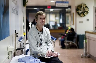 Frank Fournier, who was once homeless and is now a community support worker at St. Michael's Hospital helping homeless patients navigate the emergency room, poses for a photo in the Toronto hospital on Thursday, December 6, 2012. THE CANADIAN PRESS/Michelle Siu