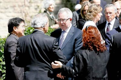 Manitoba Lt.-Gov. Philip Lee (left), former prime minister Joe Clark (centre), former premier Gary Filmon (right) outside the funeral service Thursday for Duff Roblin.