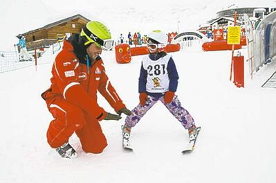 Instructor Peter Steinwender shows seven-year-old Julia Mallen from Toronto the �pizza� technique for her skis at Skischule Serfaus.