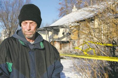 John Johnson smelled smoke and went outside to see his neighbour's house on Taylor Avenue in Selkirk in flames Monday night.