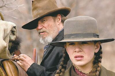 Jeff Bridges plays Rooster Calhoun and Hailee Steinfeld plays Mattie Ross in the Coen brothers version of True Grit.