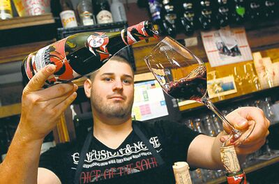A server pours Beaujolais Nouveau in Bayonne, France on Thursday.