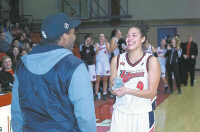 KELLY MORTON PHOTOGRAPHYWesmen�s Tia Ruddock asks for boyfriend Ramon Burke�s hand in marriage at courtside Friday night.