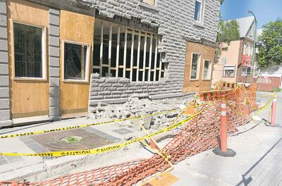 An area in front of the building at 543 Sargent Avenue is sectioned off as the sidewalk has dropped at least a third of a metre and bricks have fallen off the building's exterior.