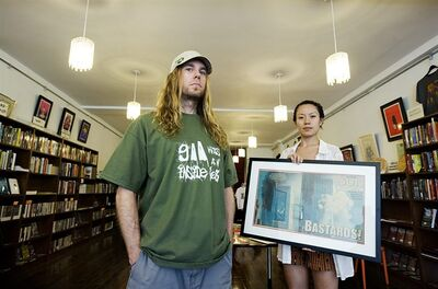 Co-Owners of Conspiracy Culture Patrick Whyte and Kadina Yu pose for a photo in their store in Toronto on Thursday August 11, 2011. THE CANADIAN PRESS/Aaron Vincent Elkaim