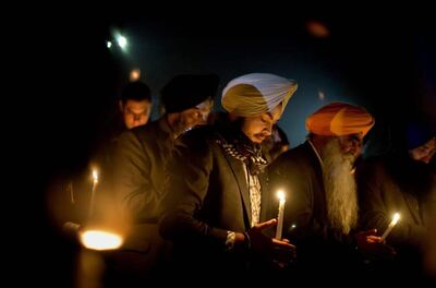 Sikhs pray at a memorial service for the victims of the Sandy Hook Elementary School shooting.