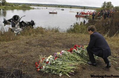 Russian President Dmitry Medvedev visits site of crash that killed 43 players, hockey staff and flight-crew members.