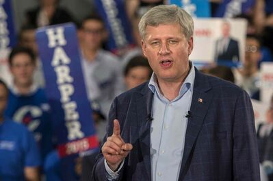 Conservative Leader Stephen Harper addresses supporters during his first campaign event on Sunday in Montreal. THE CANADIAN PRESS/Paul Chiasson