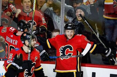 Calgary Flames' Kris Versteeg, right, celebrates his goal with teammates during third period NHL hockey action against the St. Louis Blues, in Calgary on Monday, Nov. 13, 2017. THE CANADIAN PRESS/Jeff McIntosh
