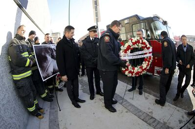 TREVOR HAGAN / WINNIPEG FREE PRESS</p><p>Mayor Brian Bowman, Alex Forrest of the United Fire Fighters of Winnipeg, Manitoba Hydro CEO Kelvin Shepherd and members of the Winnipeg Fire Paramedic Service pay tribute at a ceremony Friday for the men killed in the 1926 blaze.</p>