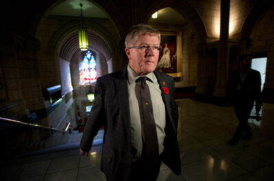 Conservative Sen. Don Plett arrives to the Senate on Parliament Hill in October 2013.