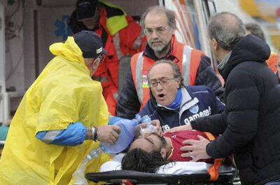 Medics attempt to revive Livorno's Piermario Morosini at the Pescara's Adriatico stadium in Italy Saturday.