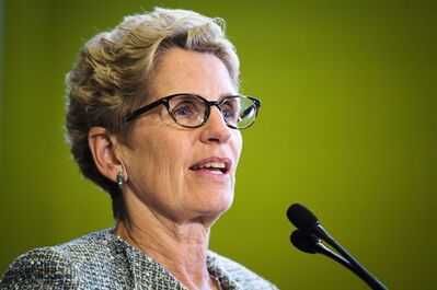 Ontario Premier Kathleen Wynne is shown in Toronto Monday, September 16, 2013. THE CANADIAN PRESS/Mark Blinch