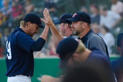 Winnipeg Goldeyes pitching coach Bill Pulsipher, right, with beard,  is leaving the club for personal reasons.