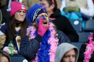 A Winnipeg Blue Bombers fan offers his two cents Saturday —perhaps a new team slogan, albeit not laced with too many obscenities.