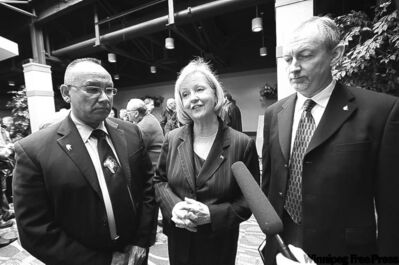 From left: Ron Evans, Joy Smith and Brian McConaghy attend prayer breakfast Saturday.