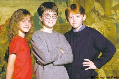Eleven year-old British actor Daniel Radcliffe, center, poses for a photo with newcomers, Emma Watson,10, left, and Rupert Grint,11.