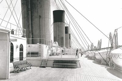 The Titanic's second-class deck, with row of lifeboats that would soon be pressed into service.