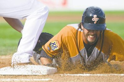 Sioux Falls Pheasants' Jonny Kaplan gets back safely after an attempted pick-off at first base by Goldeyes pitcher Todd Privett on Saturday night.