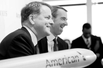 LM Otero / The Associated PressUS Airways CEO Doug Parker (left) and American Airlines CEO Tom Horton like what they see during a news conference at DFW International Airport in Grapevine, Texas, on Thursday. The two airlines are forming the world�s largest airline.
