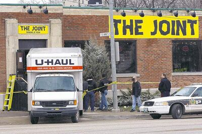 Police load a U-Haul with items from The Joint head shop at St. Mary's Road and St. Anne's Road on Wednesday morning.