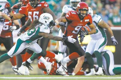 Stamps' rushing phenom Jon Cornish (9) breaks free as part of a history-making four-TD performance last week against Saskatchewan.