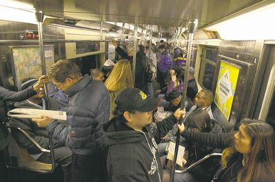 Richard Drew / The Associated Press archives Morning commuters ride a downtown-bound, west side subway train toward New York�s Times Square. Is gender a factor in where newcomers decide to sit?