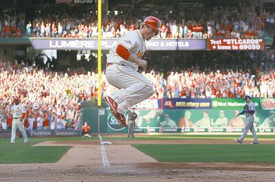 Chris Lee / St. Louis Post-Dispatch / MCTSt. Louis Cardinals� 3B David Freese hops to his feet after scoring the game�s only run.