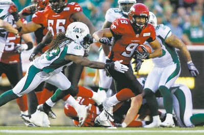 Jeff McIntosh / the canadian press archivesStampeders running back Jon Cornish topped the CFL in rushing yards for the second straight season.