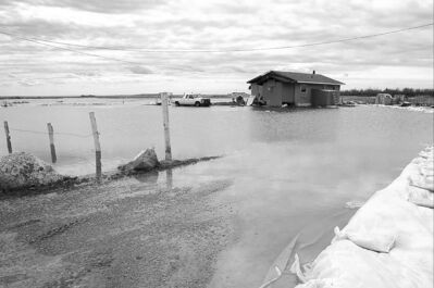 A home surrounded by flood water at Lake St. Martin First Nation in 2011.