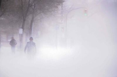A pedestrian walks southbound on Hargrave Street towards Portage Avenue through blowing snow, Saturday.