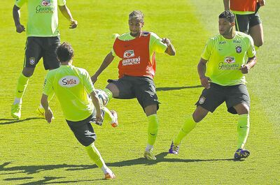 Brazil's Neymar (centre) practises with Hulk (right) and Bernard on Friday in preparation for the game vs. Chile.