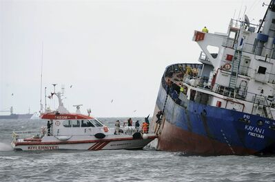 Coast guard members climb into the tilting Sierra Leone-flagged Kayan-1, an 86-meter (282-feet) freighter carrying empty containers, as crew pumped out water, and a tugboat stands by , in the Bosporus, Istanbul, Turkey, Friday, Jan. 20, 2012. The cargo ship's struggle comes during a time of heightened attention on ship safety following last week's grounding of the Costa Concordia cruise ship off Italy's coast, an accident that killed 11 people and left 21 still missing. (AP Photo)
