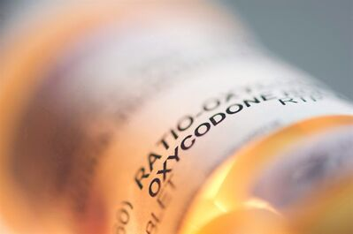 Prescription pill bottle containing oxycodone is pictured in a June 20, 2012 photo. THE CANADIAN PRESS/Graeme Roy