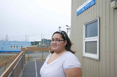 Katrina Pameolik, who works as a receptionist in Rankin Inlet's public health building, says she won't give up on her dream of becoming a midwife.