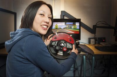 University of Alberta researcher Michelle Chan is shown in a handout photo with a driving simulator. Chan wants to put the brakes on billboards with negative words. She says her recently published study shows negative words on roadside ads lead to more distracted driving.THE CANADIAN PRESS/HO-University of Alberta-Richard Siemens