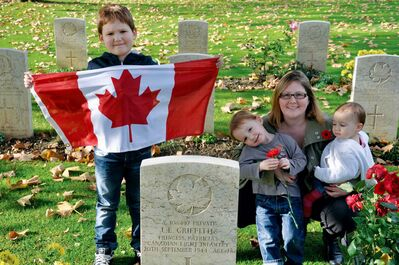 Corrin Fraser and her children Aiden, Liam, and Avery are shown at Coriano Ridge War Cemetery in Coriano, Italy.
