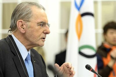 International Olympic Committee, IOC, President Jacques Rogge gestures during a press conference after the last day of the executive board's meeting, in Lausanne, Switzerland, Wednesday, Feb. 13, 2013. IOC President Jacques Rogge says he will meet with the head of wrestling's governing body to discuss ways the sport can fight to save its place in the 2020 Olympics. The IOC executive board dropped wrestling from the program of the 2020 Games on Tuesday, removing it from the list of 26 sports contested at last year's London Olympics. The decision, which still must be ratified by the full IOC in September, has been widely criticized by wrestling organizations around the world. (AP Photo/Keystone,/Laurent Gillieron)