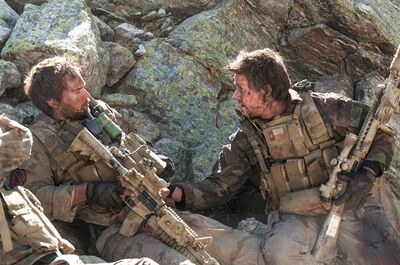"FILE - This file photo released by Universal Pictures shows Taylor Kitsch, left, as Michael Murphy and Mark Wahlberg as Marcus Luttrell in a scene from the film, ""Lone Survivor."" The Navy SEAL drama earned $37.8 million in its first weekend of wide release. (AP Photo/Universal Pictures, Gregory R. Peters, File)"