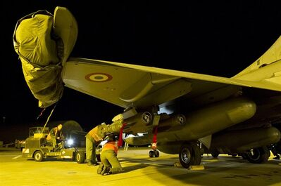 This Sunday Jan.13, 2013 photo provided by the French Army Monday Jan.14, 2013 shows soldiers preparing a French Rafale jetfighter from the Saint Dizier airbase, eastern France. French fighter jets bombed rebel targets in a major city in Mali's north Sunday, pounding the airport as well as training camps, warehouses and buildings used by the al-Qaida-linked Islamists controlling the area, officials and residents said. (AP Photo/Laure-Anne Maucorps, ECPAD)