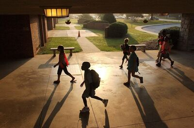***FOR USE WITH AP LIFESTYLES*** - FILE- In this Aug. 25, 2006 file photo, Whitehall Elementary School children, including safety patrol fifth graders wearing orange vests, walk back into school as the 8 a.m. bell and start of a school day nears, in Anderson, S.C. Getting children up early for the first day of school after they've slept late all summer causes their bodies naturally to rebel. As they drag through the first weeks of school exhausted, that lack of sleep affects their ability to learn and to remember, and may even erode their ability to handle their emotions, experts say. (AP Photo/Independent-Mail, Ken Ruinard, File)