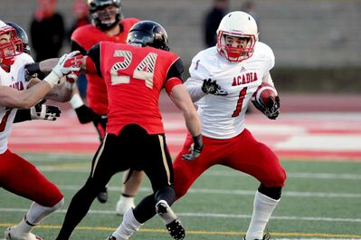 .Taylor Renaud (with ball), Winnipeg born and bred wide receiver, has been recruited to the Winnipeg Blue Bombers.