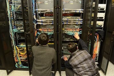 In this photo released by Korean Broadcasting System, KBS employees try to recover a computer server a day after a cyberattack caused computer networks at the company to crash, in Seoul, South Korea, Thursday, March 21, 2013. Investigators have traced a coordinated cyberattack that paralyzed tens of thousands of computers at six South Korean banks and media companies to a Chinese Internet Protocol address, but it was not yet clear who orchestrated the attack, authorities in Seoul said Thursday. The discovery did not erase suspicions that North Korea was to blame. IP addresses are unique to each computer connected to the Internet, but they can easily be manipulated by hackers operating anywhere in the world. (AP Photo/KBS)
