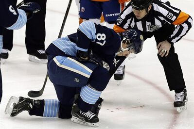 Pittsburgh Penguins center Sidney Crosby (87) is helped by referee Ian Walsh (29) after being hit in the face with a puck during the first period of an NHL hockey game against the New York Islanders in Pittsburgh, Saturday, March 30, 2013. (AP Photo/Gene J. Puskar)
