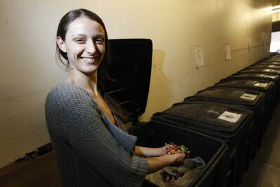 Alana Lajoie-O'Malley, seen here with some on-campus compost bins, is director of the Campus Sustainability Office at the University of Winnipeg.