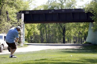 A golfer tees off on the 10th hole of the Kildonan Park Golf Course.